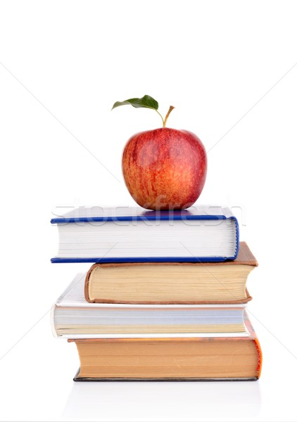 Apple on few school books isolated on a white background Stock photo © dla4