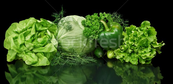 Set of green vege-cabbage,lettuce,bell pepper,dill on black isolated Stock photo © dla4