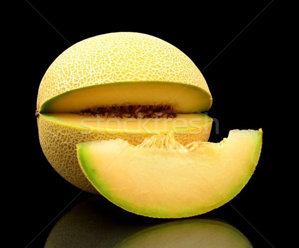 Melon galia notched with slice isolated black in studio Stock photo © dla4