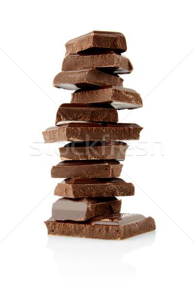 Pile of blocks of chocolate on white background Stock photo © dla4