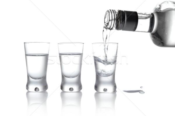Botella gafas vodka vidrio aislado primer plano Foto stock © dla4