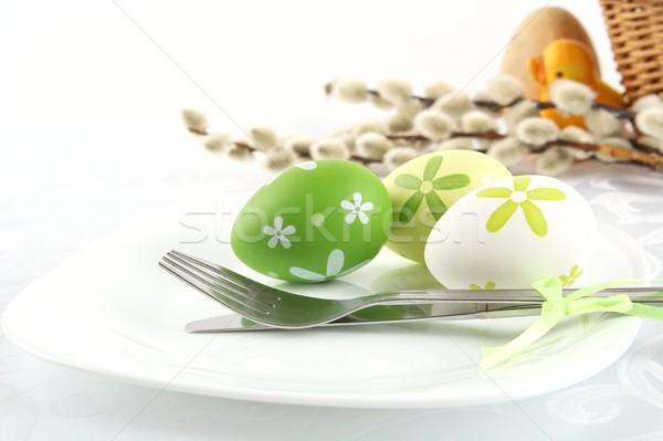 Pasztell színes húsvéti tojások kosár három tányér Stock fotó © dla4