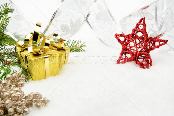 Stock photo: Gold christmas gifts with silver ribbon and needles fir with red