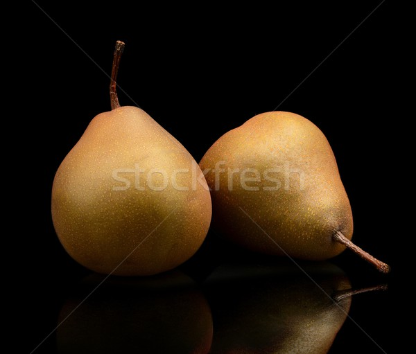 Two pair pears called manon isolated on black Stock photo © dla4