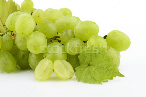 Bunch of white grapes on white with vine leaves branch Stock photo © dla4