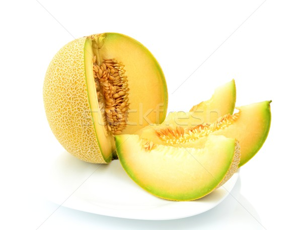 Melon galia with slices on plate isolated white in studio Stock photo © dla4