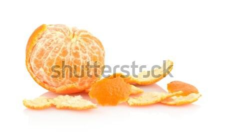 Single peeled mandarine with rind isolated on white Stock photo © dla4