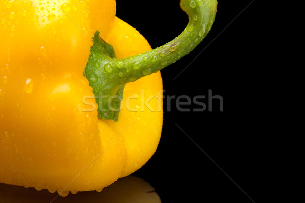 Cut shot of yellow bell pepper isolated on black with water drop Stock photo © dla4
