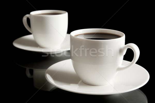 Cups of coffee with saucer isolated on black Stock photo © dla4