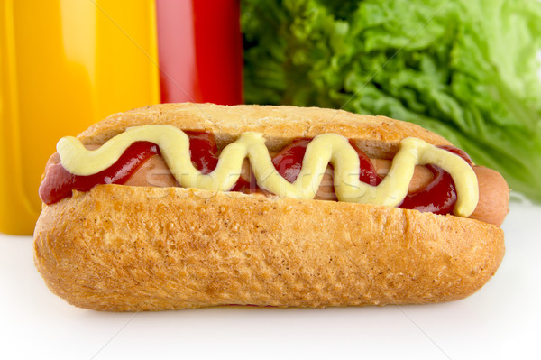 Hotdog with ketchup and mustard with salad in the background Stock photo © dla4