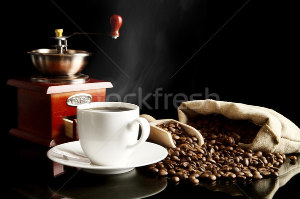Cup of coffee with saucer,bag,coffee beans on black Stock photo © dla4