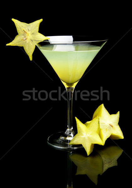 Cosmo margarita drink with carambola fruit on black Stock photo © dla4