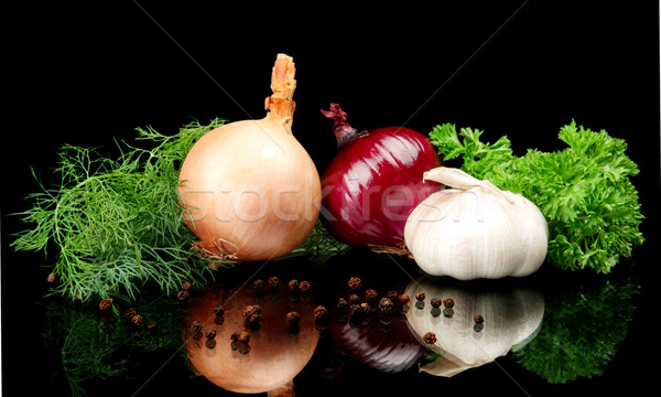 Onions,red onions,dill,pepper,allspice and garlic isolated on black Stock photo © dla4