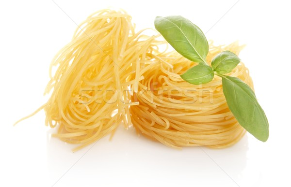 Closeup shot of tagliatelle with basil isolated on white Stock photo © dla4