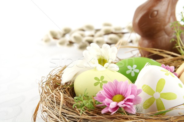 Photo easter eggs nest with flowers,chocolate hare,catkins Stock photo © dla4