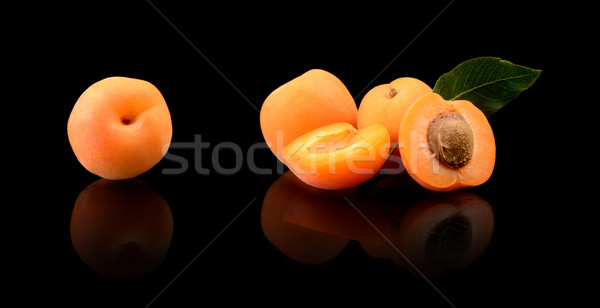 Three sliced apricots isolated on black Stock photo © dla4