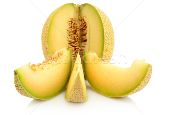 Closeup melon galia with slices isolated on white Stock photo © dla4