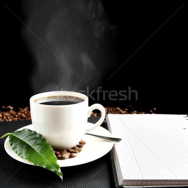 Cup of coffee with haze with notebook and coffee leaf at breakfast Stock photo © dla4