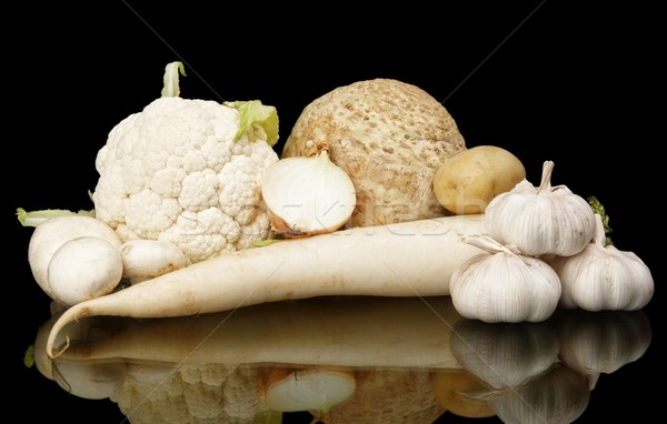Collection of white vegetables on black with reflection Stock photo © dla4