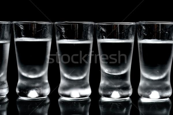Beaucoup verres vodka isolé noir Photo stock © dla4