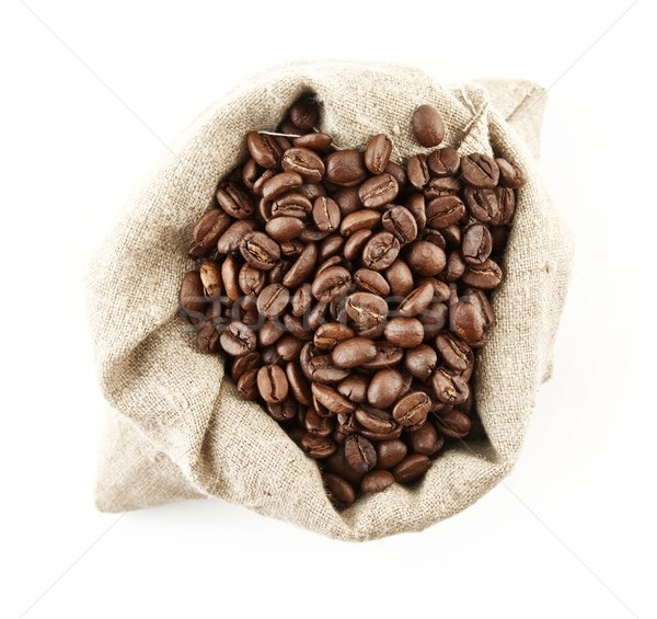 Sack full of coffee beans on white view from above Stock photo © dla4