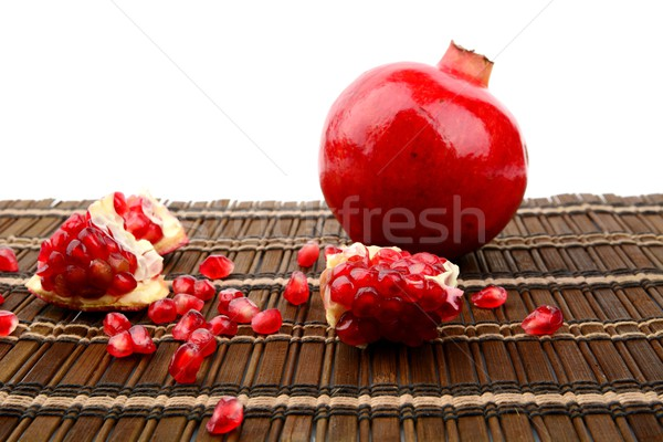Studio shot open pomegranate on brown wooden mate Stock photo © dla4