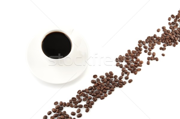 Coffee beans arranged diagonally with coffee cup on white Stock photo © dla4