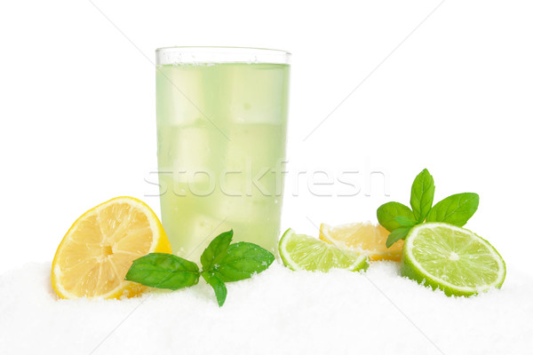 Mojito drink on ice with lemons,limes,leaves on white Stock photo © dla4
