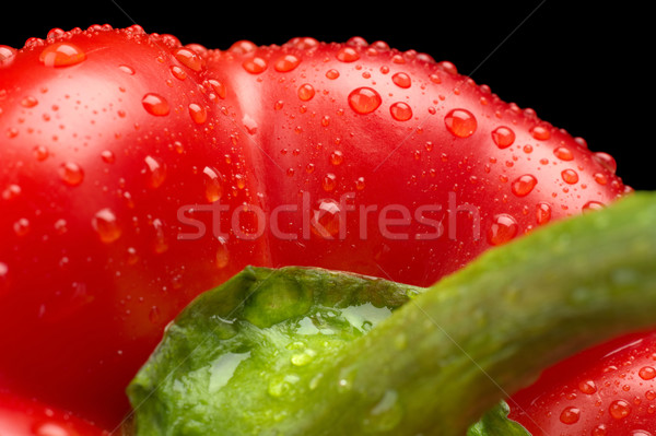 Macro cut shot of red bell pepper background with water drops Stock photo © dla4