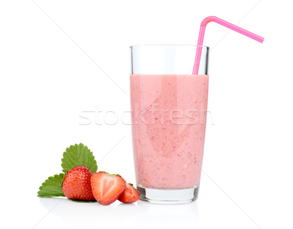 Several sliced strawberries with leaf,juice and straw isolated Stock photo © dla4