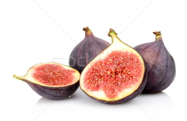 Four sliced figs isolated on white background Stock photo © dla4