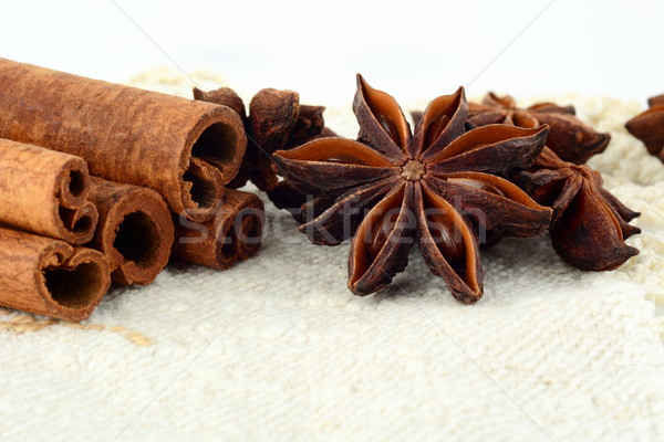 Closeup set of anise and cinnamon on white flax Stock photo © dla4