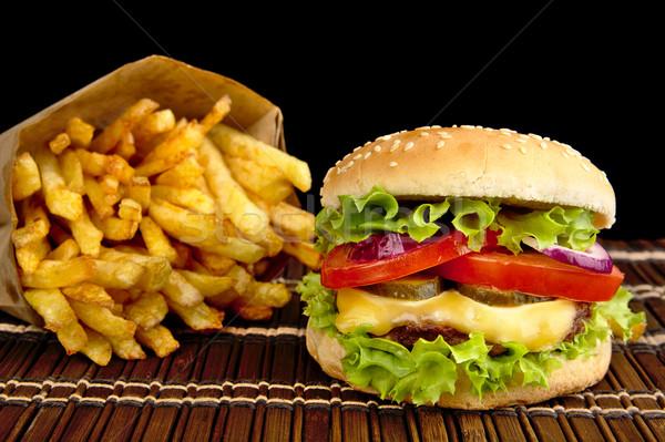 Grande cheeseburger patatine fritte legno nero carta Foto d'archivio © dla4