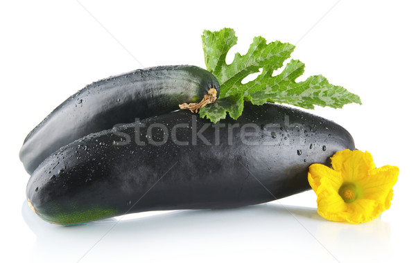 Mature zucchinis with flowers on white background Stock photo © dla4