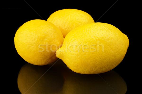 все три лимоны изолированный черный Сток-фото © dla4