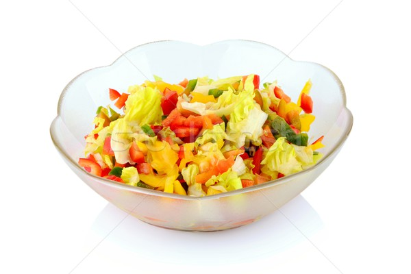 Full diversity of vegetables in the salad-bowl isolated Stock photo © dla4