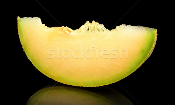 Melon galia slice, piece isolated black in studio Stock photo © dla4