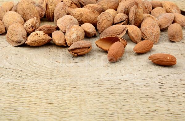 Csoport mandulák kagyló fából készült palánk gyümölcs Stock fotó © dla4