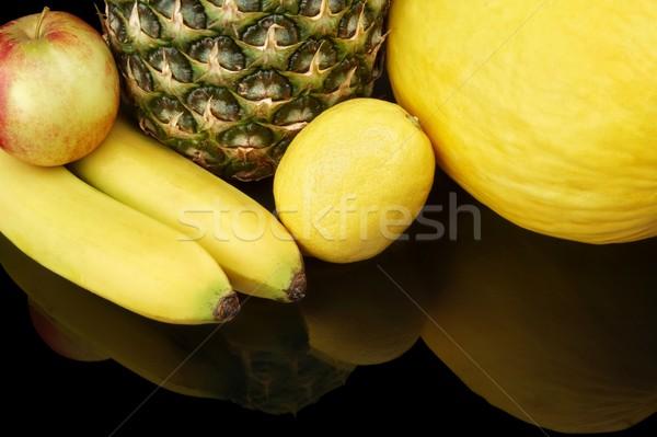 Set of yellow fruits-pineapple,citrus,bananas on black at the bottom Stock photo © dla4