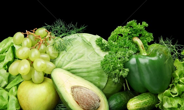 Group of green vegetables and fruits at the bottom horizontal view on black Stock photo © dla4