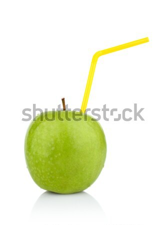Studio shot of whole green apple with straw as drink Stock photo © dla4