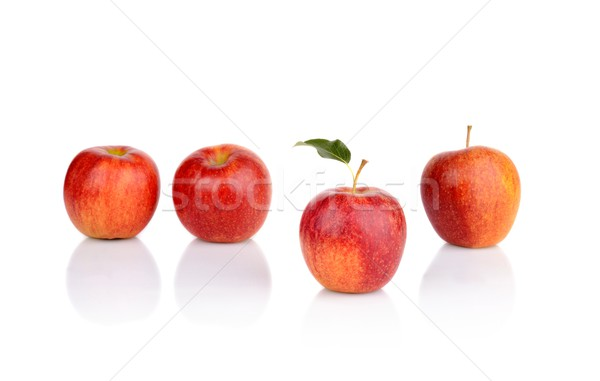 Stock photo: Apple which stands out from the crowd isolated