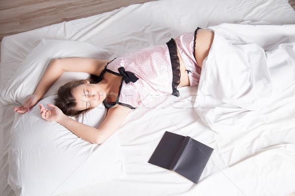 Lány pizsama ágy könyv gyermek fény Stock fotó © dmitriisimakov