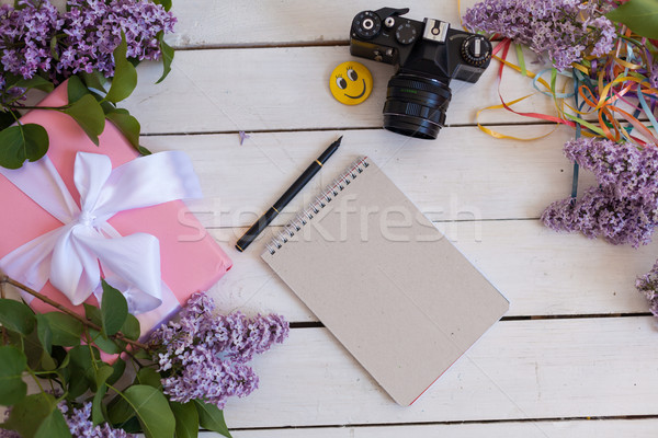 on the white table lilac, gift, notebook Stock photo © dmitriisimakov