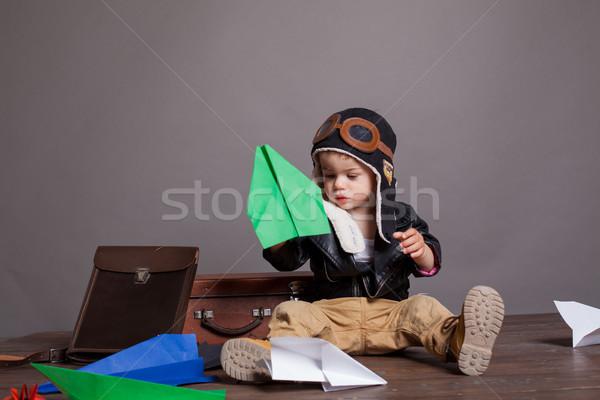 little boy pilot plays in the paper plane Stock photo © dmitriisimakov