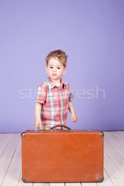 little boy going on a journey with suitcase Stock photo © dmitriisimakov