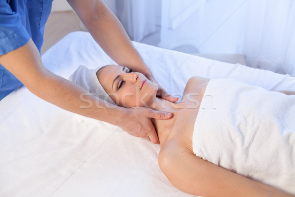girl masseur doing massage in spa health Stock photo © dmitriisimakov