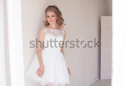 pretty girl in a short white wedding dress Stock photo © dmitriisimakov