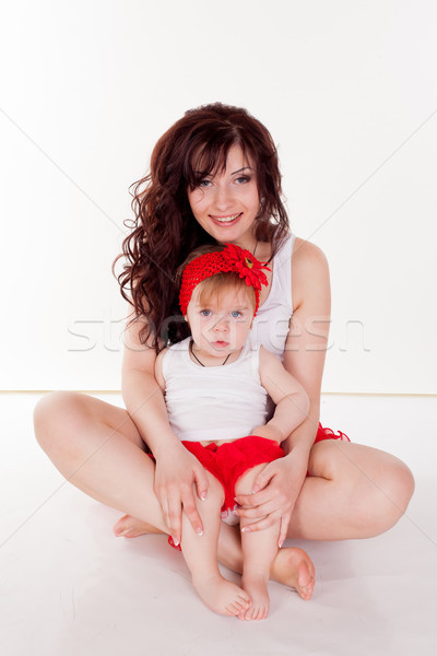 Stock photo: mother and little daughter in red skirts