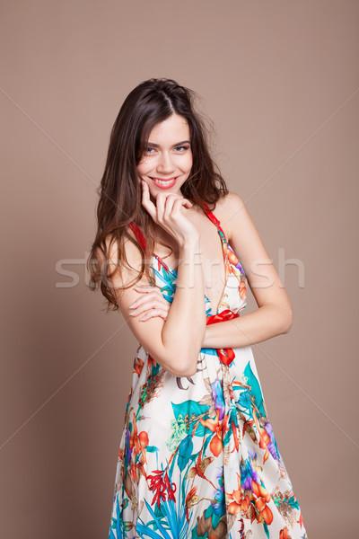 Beautiful girl in colored dress posing smile Stock photo © dmitriisimakov